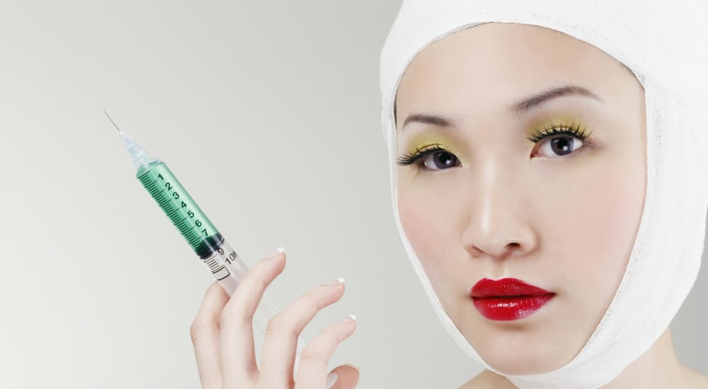 woman cosmetic surgery using collagen injections