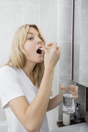 woman taking a healthy collagen supplement